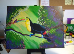 More work on the foliage highlights, and work on the toucan's beak. Adjusting some shades of the bird's yellow chest.